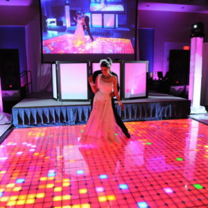couple dancing on LED lit dance floor